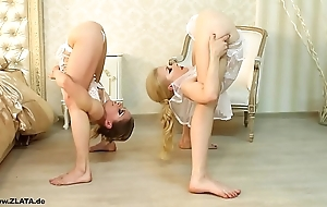 Contortionists zlata and tanya in all directions abut on